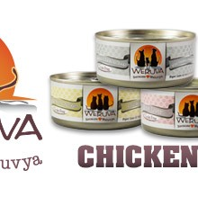 Image of Weruva cat food label next to three tins of cat food